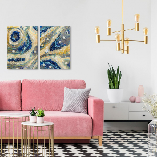 pink sofa and gray walls and a picture colorful arrangement